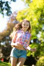 Young girl running outdoors happy Royalty Free Stock Photo
