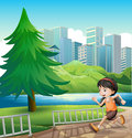 A young girl running at the riverbank illustration of Royalty Free Stock Photography