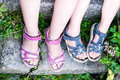 Young girl`s legs with sandals Royalty Free Stock Photo