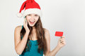 A young girl with santa claus hat and card joy smile Stock Photo