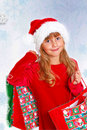 Young girl in santa cloth with gift bags Stock Image