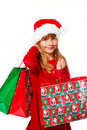 Young girl in santa cloth with gift bags Stock Photos