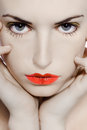 Young girl seductress beautiful caucasian woman playing with heart drawing on lips Royalty Free Stock Images