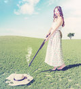 Young girl shot a hat beautiful flying creative concept photo and cg elements combinated Stock Image