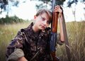Young girl with a shotgun in an outdoor Royalty Free Stock Photo