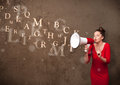Young girl shouting into megaphone and text come out abstract Stock Images