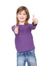 Young girl showing approval with thumbs up close portrait of a cute hand gesture Stock Image