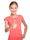 Young girl is showing thumb up gesture dressed in red isolated over white Royalty Free Stock Images
