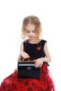 Young girl sitting with the black bag Royalty Free Stock Photo