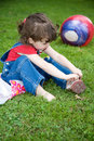 Young girl sitting on grass Stock Photos