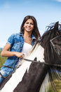 Young girl sitting on horse against blue sky portrait of Royalty Free Stock Photo
