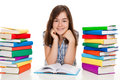 Young girl sitting between piles of book learning at home Stock Image