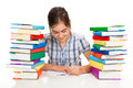 Young girl sitting between piles of book learning at home Royalty Free Stock Image