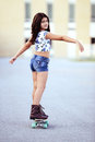 Young girl on a skate board Royalty Free Stock Photo