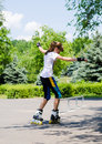 Young girl skating on rollerblades Royalty Free Stock Photo