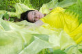 Young girl sleeps on yellow matter in nature the Royalty Free Stock Images