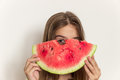 Young girl smiling and eating ripe watermelon. Healthy eating. Royalty Free Stock Photo