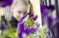 Young girl sniffing beautifull flowers Stock Image