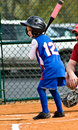 Young Girl /Softball/ At Bat Stock Images