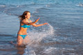 Young girl splashing on the sea Stock Photo