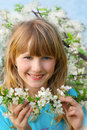 Young girl in spring orchard Stock Images