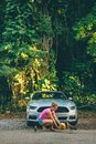 Young girl standing by the Ford Mustang GT