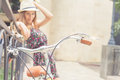 Young girl standing near fence, near vintage city bike Royalty Free Stock Photo