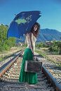 Young girl standing on a railway,running away Royalty Free Stock Photography