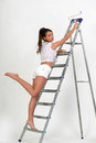 Young girl on a stepladder Stock Images