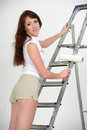 Young girl on a stepladder Royalty Free Stock Photo