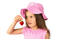 Young girl with a strawberry beautiful in polka dot dress and hat posing fresh isolated Stock Images