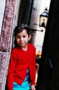 Young girl on street a a in gamla stan stockholm Royalty Free Stock Photography