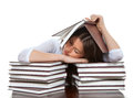 Young girl student lying on the table tired sleeping books Stock Images