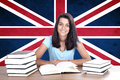 Young girl student pc on the background with uk flag english language learning concept Royalty Free Stock Image