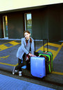 Young girl with suitcases Royalty Free Stock Photos