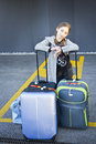 Young girl with suitcases beautiful seated and waiting two in the morning Royalty Free Stock Image