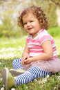 Young Girl In Summer Dress Sitting In Field Royalty Free Stock Photos