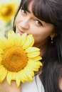 Young girl with sunflower outdoors Stock Images