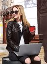 Young girl in sunglasses holding cup of coffee Royalty Free Stock Photo