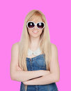 Young girl with sunglasses on a over pink background Stock Images