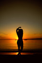 Young girl at sunset silhouette of a Royalty Free Stock Image