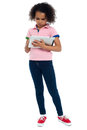 Young girl super busy in operating  tablet device Stock Photography