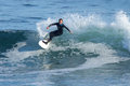 Young Girl Surfing a Wave in California Royalty Free Stock Photo