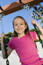 Young Girl Swaying On A Swing Stock Images