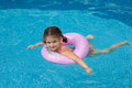 Young girl swimming in the pool Royalty Free Stock Photos