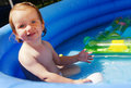 Young girl in swimming pool cute playing blue inflatable Stock Photo