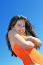 Young girl in swimming suit portrait clean blue sky vertical Stock Image