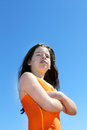 Young girl in swimming suit portrait clean blue sky vertical Stock Photo