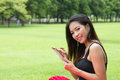 Young girl with tablet beautiful in park Stock Photos