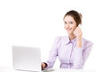 Young girl taking business call in front of laptop Royalty Free Stock Photo